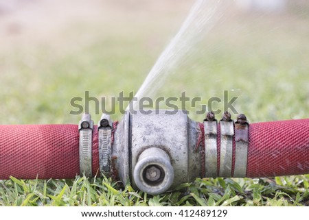 water leaking from pipeline joints - stock photo