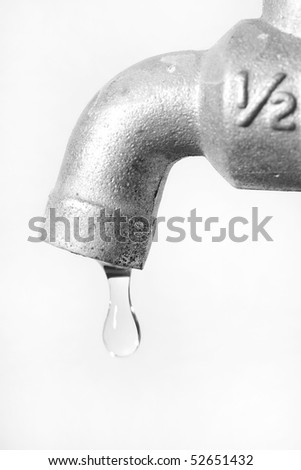 Water leaking from tap conceptual for environment preservation - stock photo