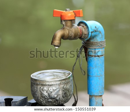 water leaking  water tap - stock photo