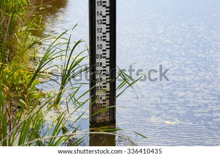 Water level measurement gauge during drought. - stock photo