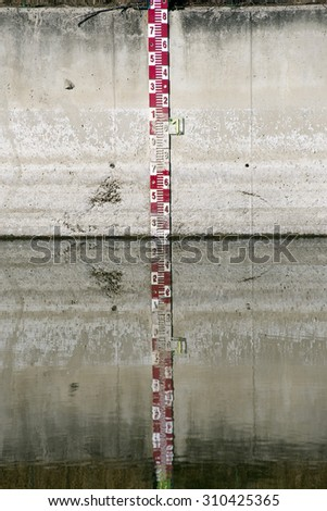 Water level measurement gauge used to monitor the water levels. - stock photo