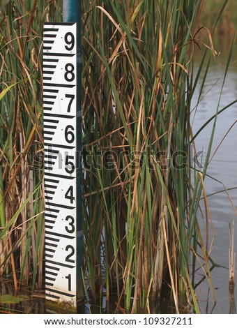 water level meter showing low levels after a period of drought - stock photo