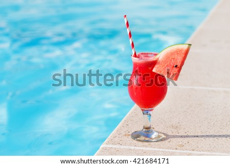 Water melon red fresh juice smoothie drink cocktail near swimming pool - stock photo