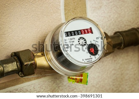 Water meters installed on the pipe and sealed - stock photo