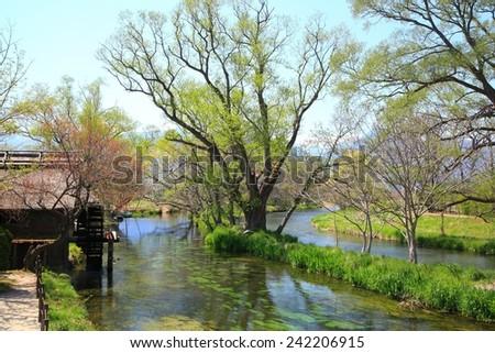 Water mill and river, Azumino, Nagano, Japan - stock photo
