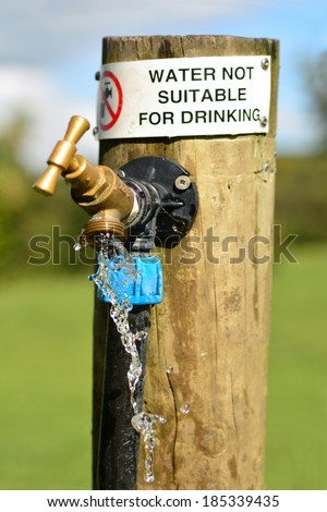 Water not suitable for drinking sign on outdoor  water tap. - stock photo