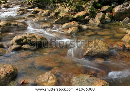Water of mountain stream at autumn time