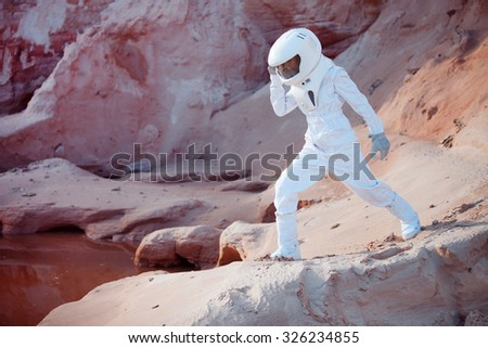 Water on Mars, futuristic astronaut, image with the effect of toning - stock photo