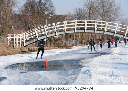 water on the ice at the mill tour - stock photo