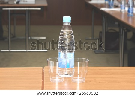 water on the table in the conference hall - stock photo