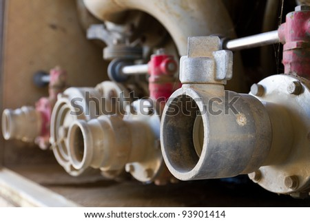 Water pipe on fire truck - stock photo