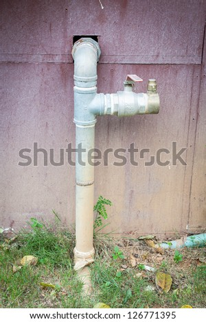 water pipe on grunge wall