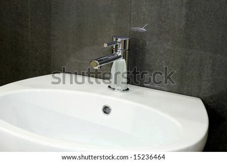 Water pipe silver faucet and white basin