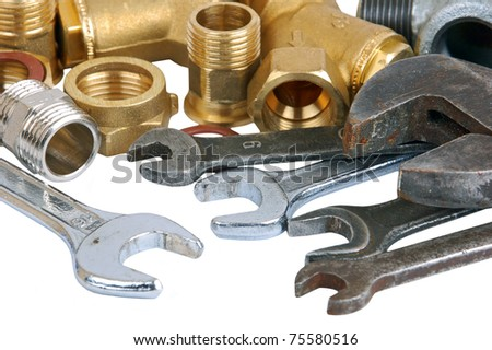 Water pipe valve and wrench, isolated on white background - stock photo