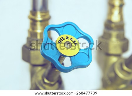 Water pipe valve close up. Creative energy management concept. (toned, filtered) - stock photo