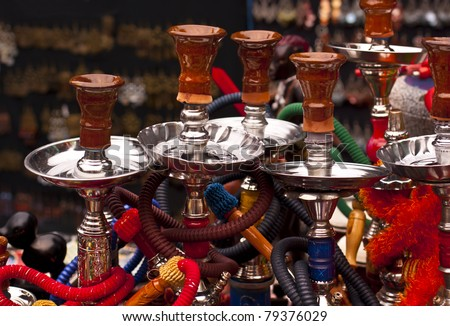 Water Pipes - Egyptians call it Shisha, Lebanese refer to it as Nargile, in English, it is Hookah. - stock photo