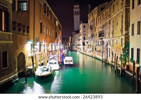 Water police boats in Venice at night - stock photo