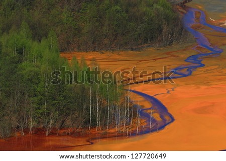Water polluted by copper mining at Geamana lake, Romania - stock photo
