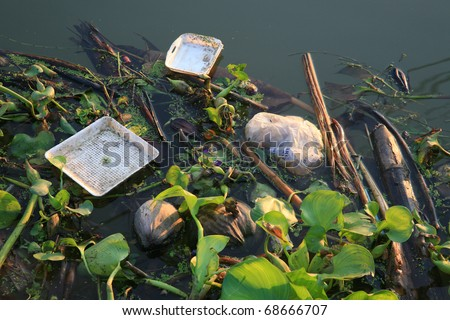 Water pollution / garbage in river - stock photo