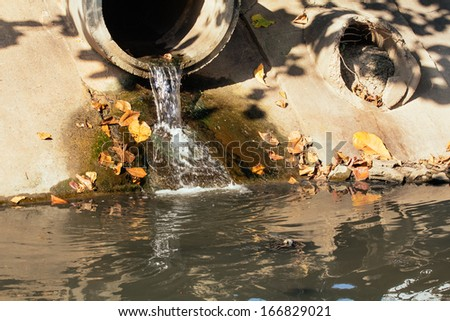 Water pollution in river because industrial not treat water before drain. - stock photo