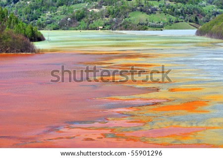 Water pollution of a copper mine exploitation - stock photo