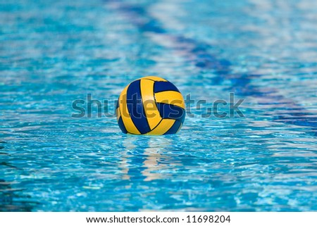 Water polo action and equipment in a swimming pool