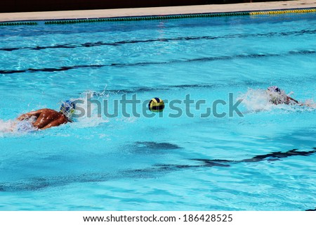 Water polo action and equipment in a swimming pool - stock photo