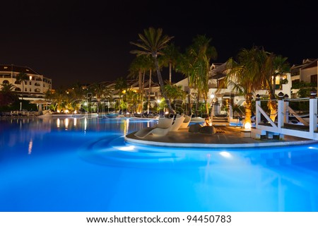 Water pool at night - vacation background - stock photo