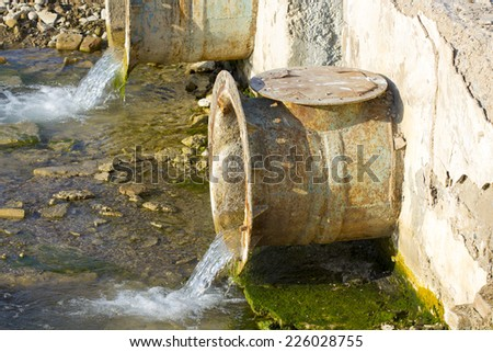 Water poured from the reservoirs through pipes - stock photo