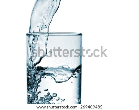 Water pouring, close up - stock photo