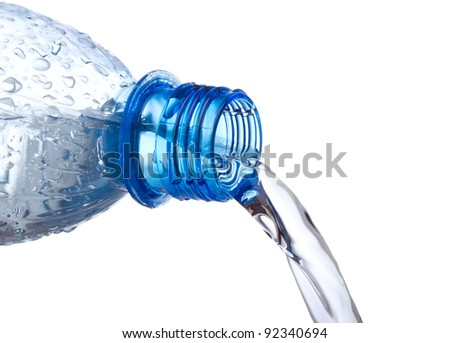 water pouring down from plastic bottle on white background