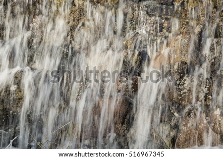 Water Pouring Down Rocks close up.