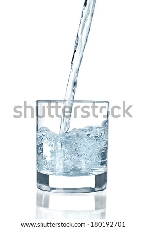 water pouring in glass isolated on white background
