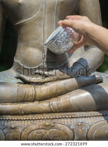 Water pouring to Buddha statue in Songkran festival. Chiangmai, Thailand.