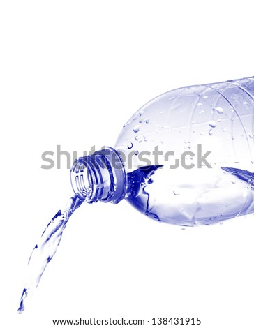 Water pours from a plastic bottle isolated on white background - stock photo