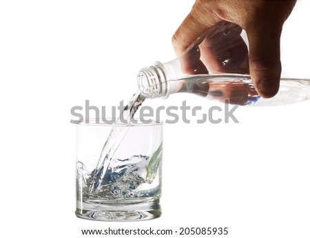 water pours into a glass from a bottle, isolated  - stock photo