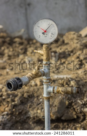 Water pressure gauge for pressure testing of water main. The black pointer show water pressure in pipe.  - stock photo