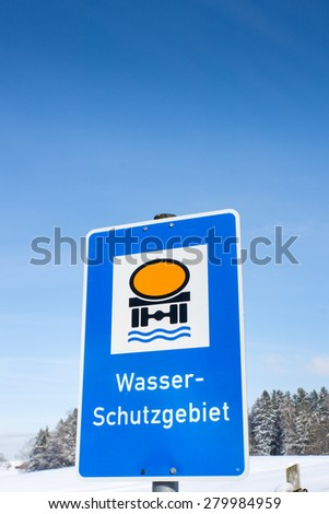 water protection area sign, germany, in winter season (wasserschutzgebiet german water protetion area) - stock photo
