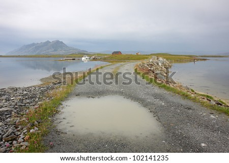 Water puddle on road at Norwegian coast