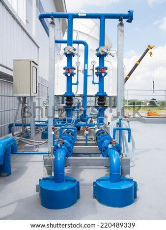 Water pump and steel pipe, blue color. - stock photo