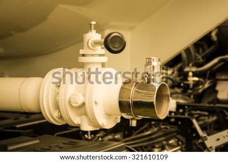 Water pump fragment with hydrant. Firefighters Equipment of fire truck, vintage color style - stock photo