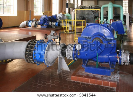 Water pumping station - industrial interior and pipes. - stock photo