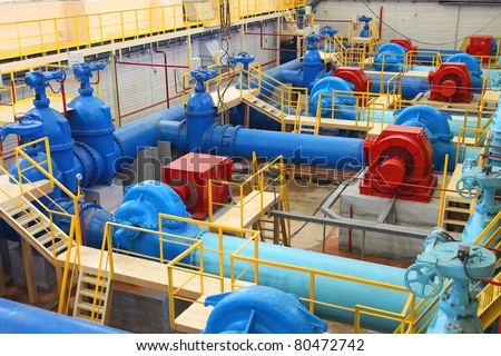 Water pumping station, industrial interior and pipes - stock photo