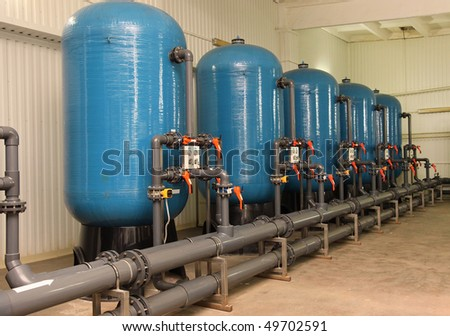 Water purification filter equipment in plant workshop - stock photo