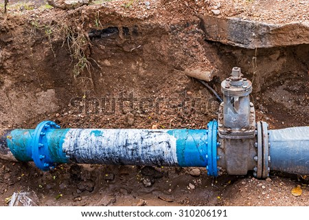 Water PVC Plastic Pipes in Ground during Plumbing Construction site. - stock photo
