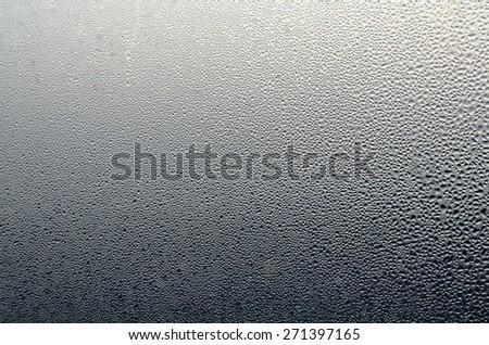 Water Rain Drop on the Glass in The Night Raining Season Dark Tone  for Texture Background - stock photo