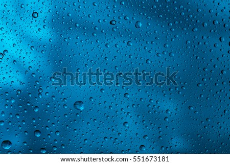 Water raindrops nano effect on a blue background