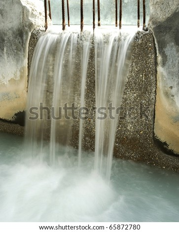 Water recycling, settling, purification on biological station. Shooting slow speed to get water flowing smooth. - stock photo