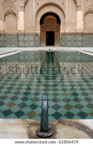 water reflection in Ben Youssef mosque courtyard - stock photo