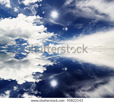 Water Reflection of Clouds and Sun